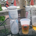 On the deck at Millstream. Sipping water with a pitcher of Pilsner. I love this place.