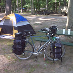 Notice the water bottles and 4 liter jug of water on picnic table along with the 2 liter on the front rack. Midge carries all that for a camping trip.